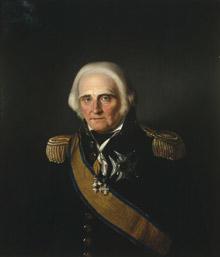 Portrett av Jens S. Fabricius. Mørk uniform, admiralsuniform. En orden festet på uniformen og to i bånd rundt halsen.