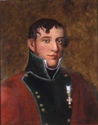 Portrett av eidsvollsmann Georg Ulrich Wasmuth.  Mann med mørkt, krøllet hår og kinnskjegg. Rød/grønn uniform med oppstående krager, hvit skjorte og svart halsbind. Små knapper. Orden på venstre bryst. (Foto/Photo)