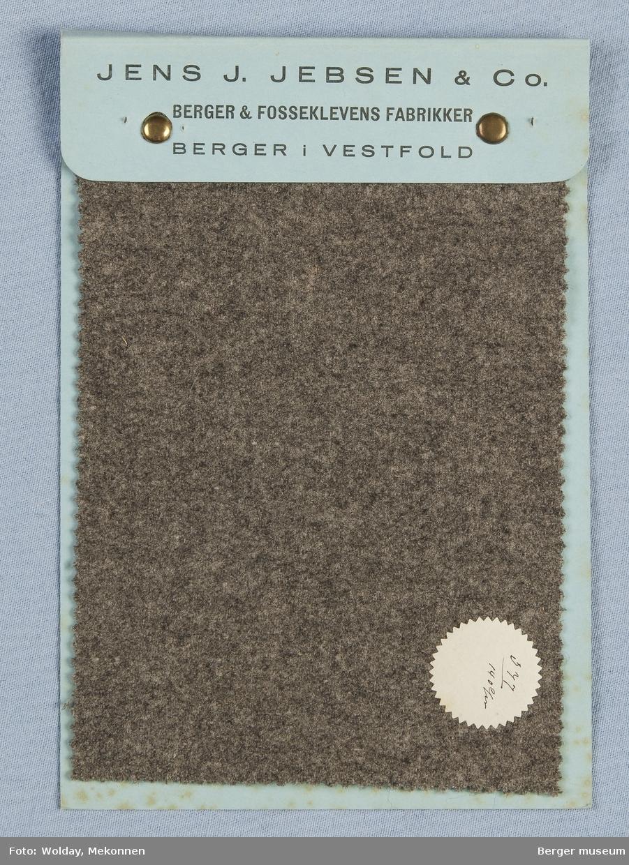 Prøvehefte med 1 prøve. Marengo lys grå (iflg. prisliste fra 1920) Kvalitet  377 Ensfarget melert