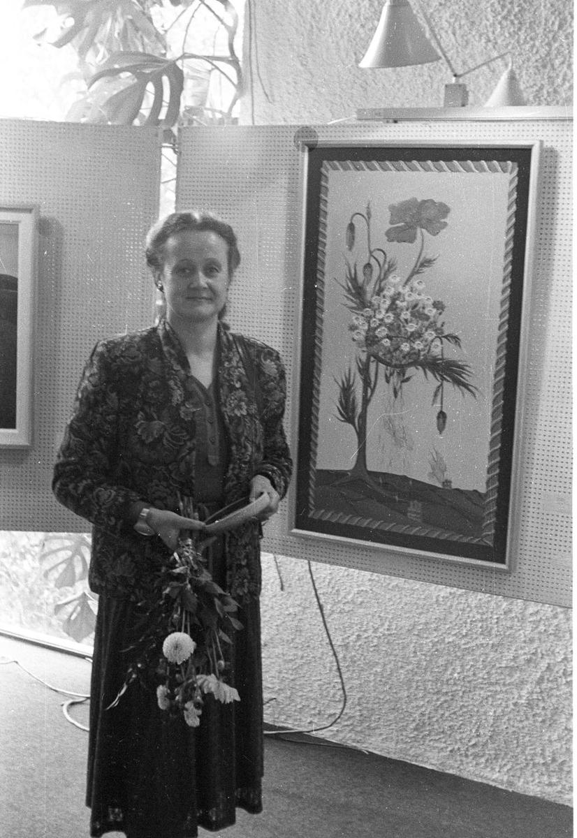 En dame og maleri