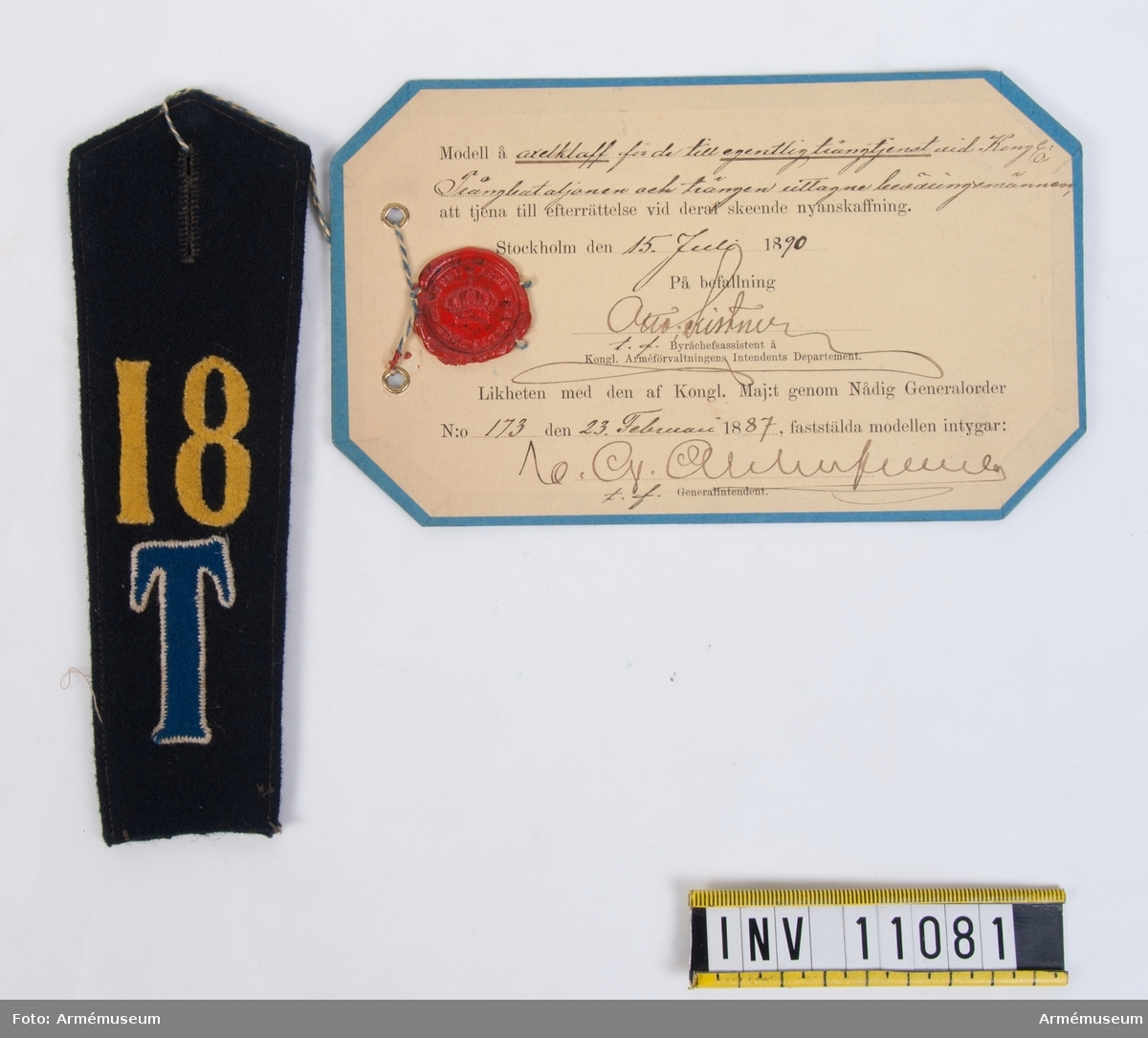 Grupp C I. Axelklaff m/1887 för de till egentlig trängtjänst vid Trängbataljonen uttagna beväringsmännen. Förmodad gåva från K. Arméförvaltningens intendentsdep.
