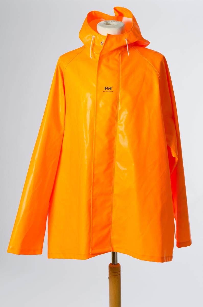 4b909050 Oransje regnjakke med dobbel stormklaff og dobbel knapping i front. HH-logo  trykt på
