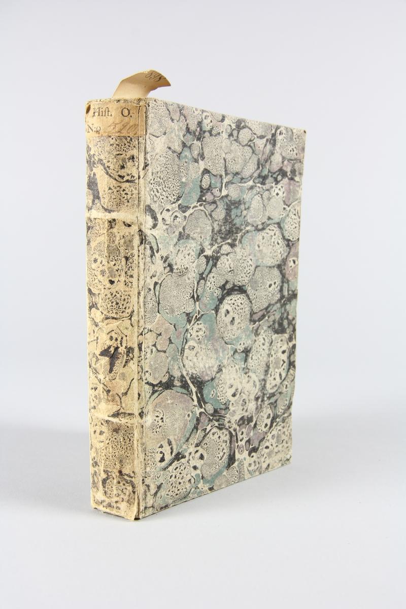 """Bok, häftad """"Joh. Fredr. Reichhardt's Bref från Paris, under hans vistande derstädes, åren 1802 och 1803"""", del 4, tryckt 1805 i Stockholm. Pärm av marmorerat papper, skuret snitt. Etikett med samlingsnummer på ryggen."""