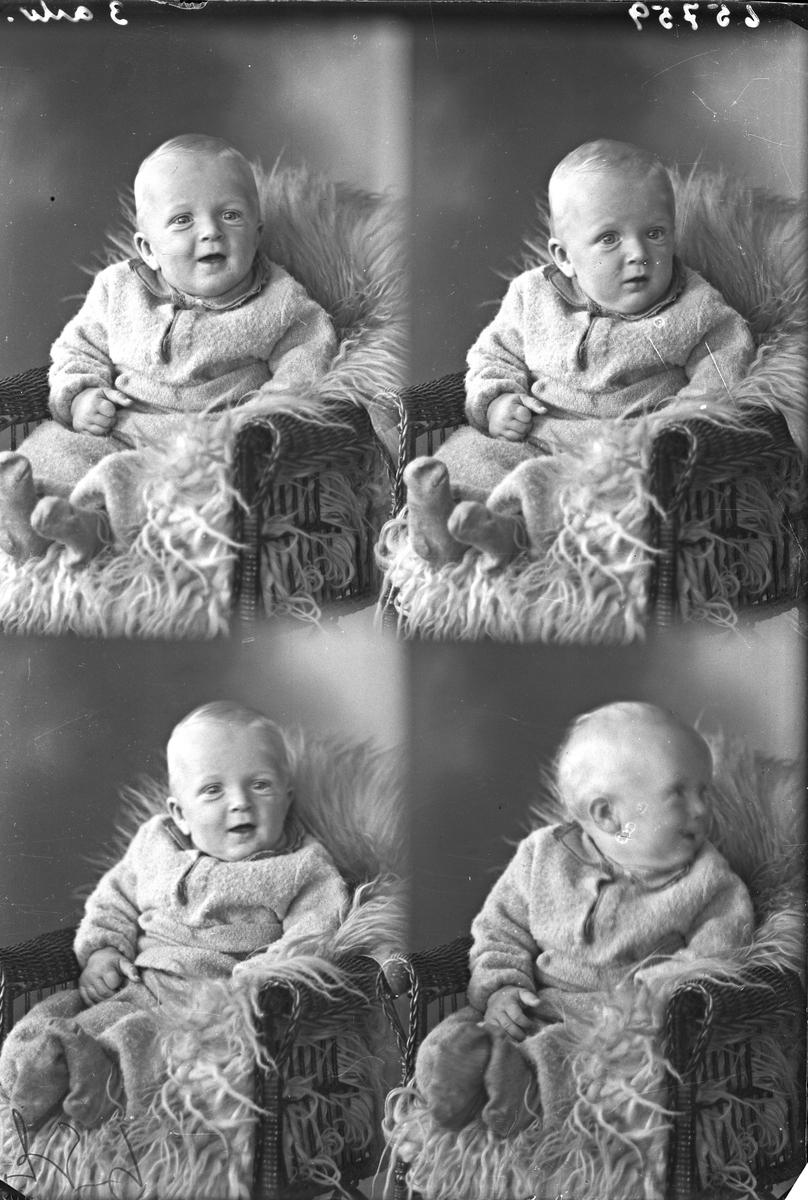 Portrett. Liten gutt sittende i en stol kledd med pels. Bestilt av Fru Hjørdis Ellefsen. Haraldsgt. 80