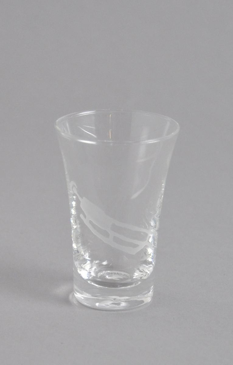 Dramglass med frostet piktogram som forestiller en utøver i aking.