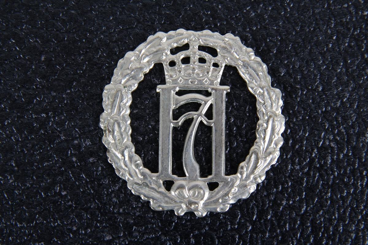 Luemerke med kongemonogram H7 med krone. (Haakon den syvende)