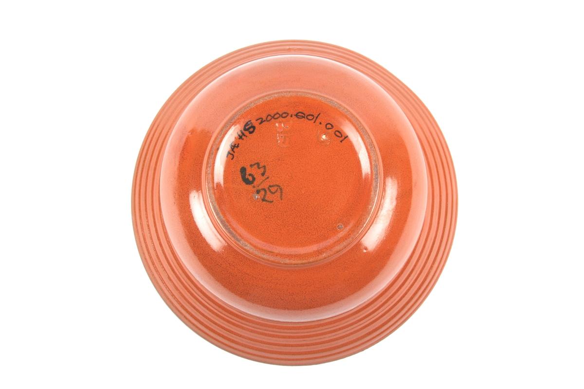 Potteskjuler i uranrød farge.