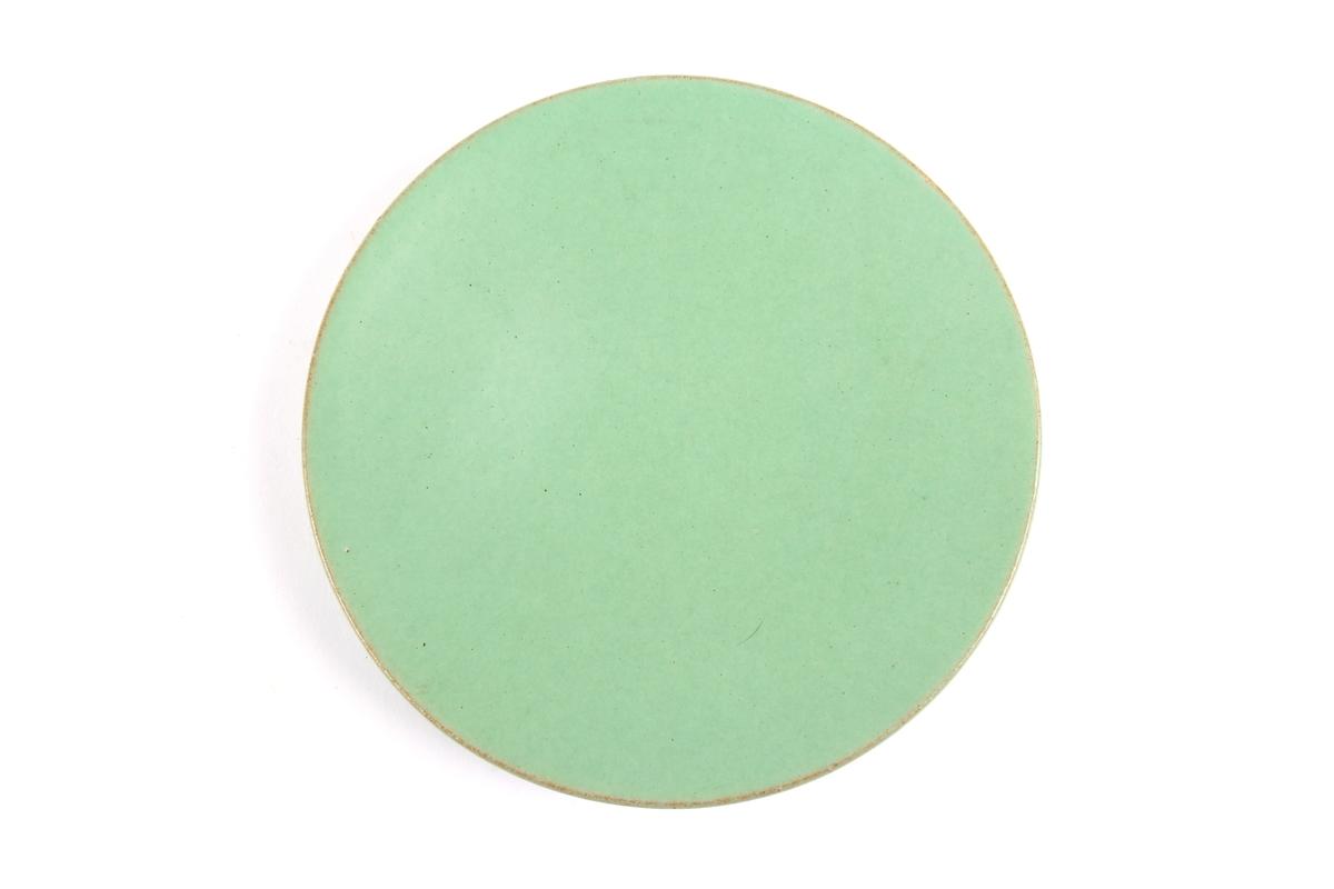 Asjett med grønn glasur.