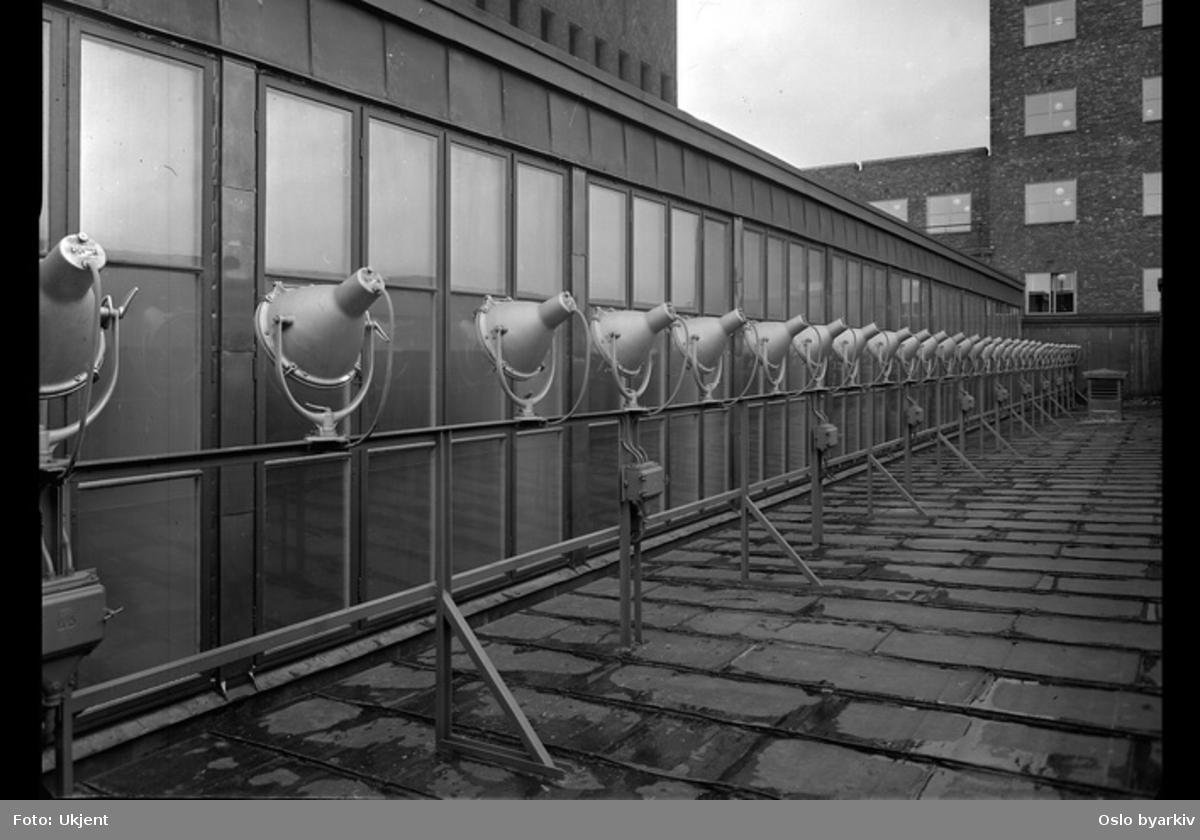 Lyskastere på taket av Rådhusets festbygg