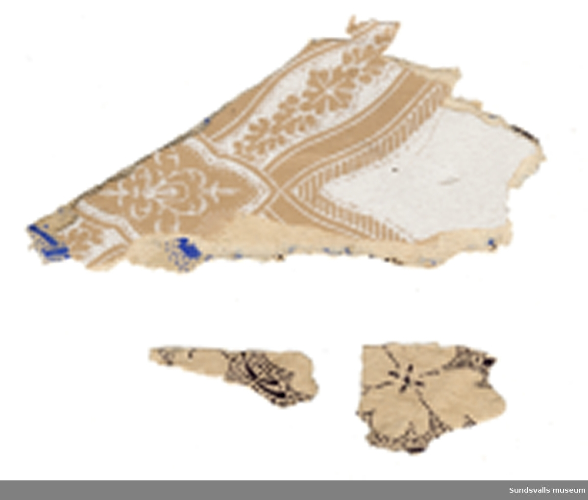 Fragment av tapet i flera lager