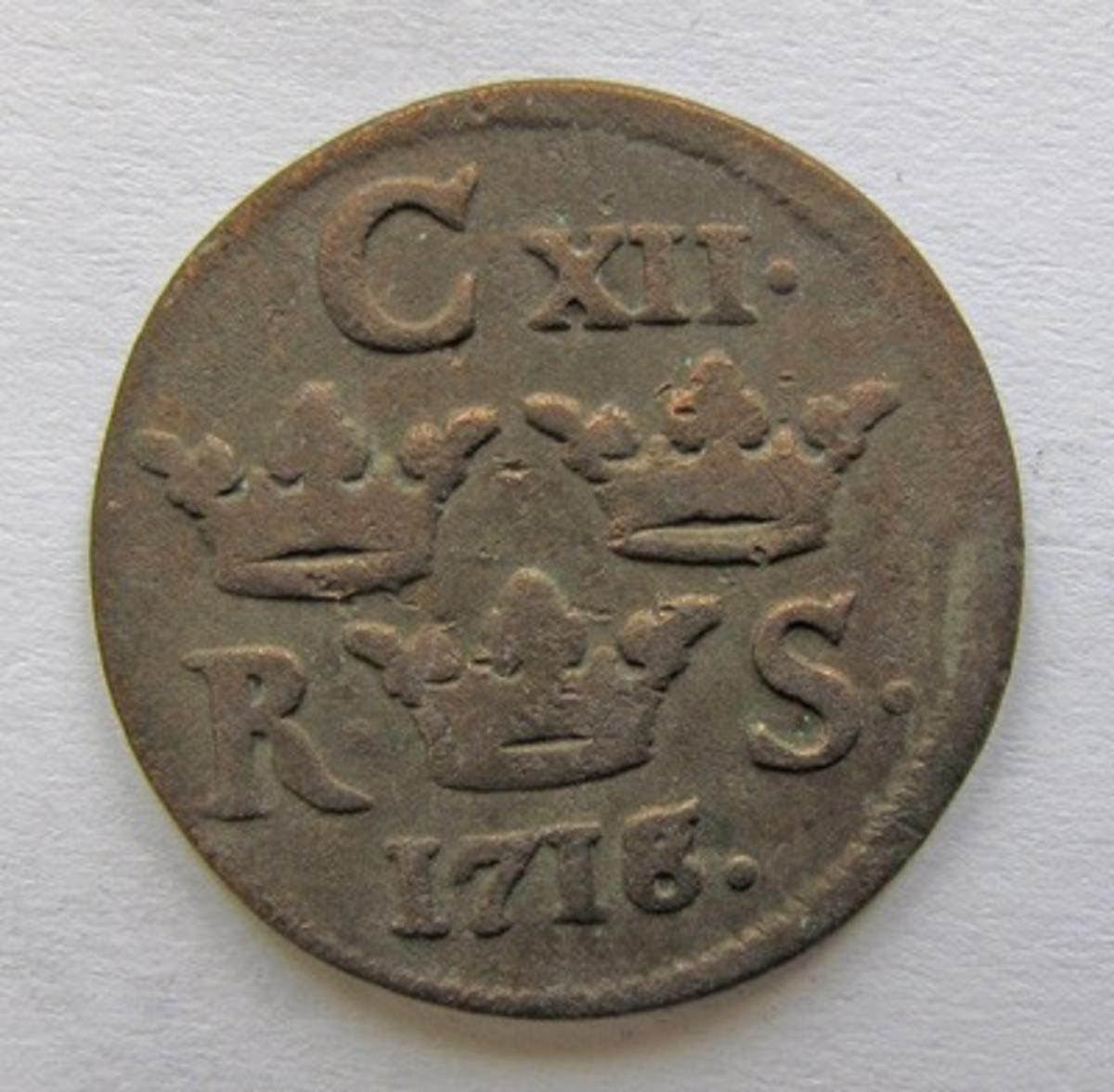 Karl XII, 1/6 öre SM kopparmynt. Präglat i Avesta 1718.
