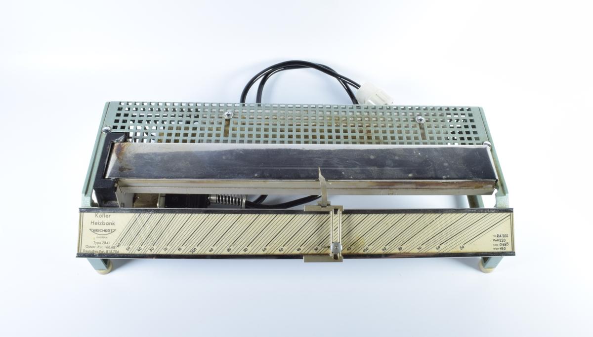 Apparat for bestemmelse av smeltepunktet til faste stoffer.