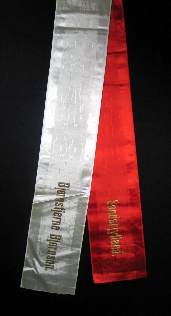 Silkesløyfe i rødt og hvitt.