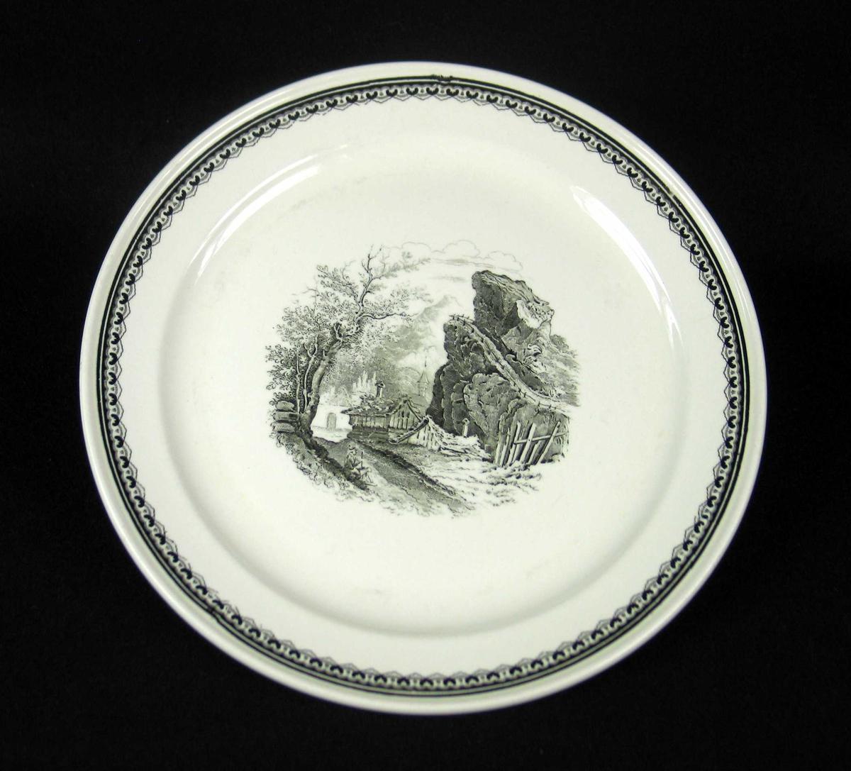 Middagstallerken i offwhite keramikk med sort dekor.