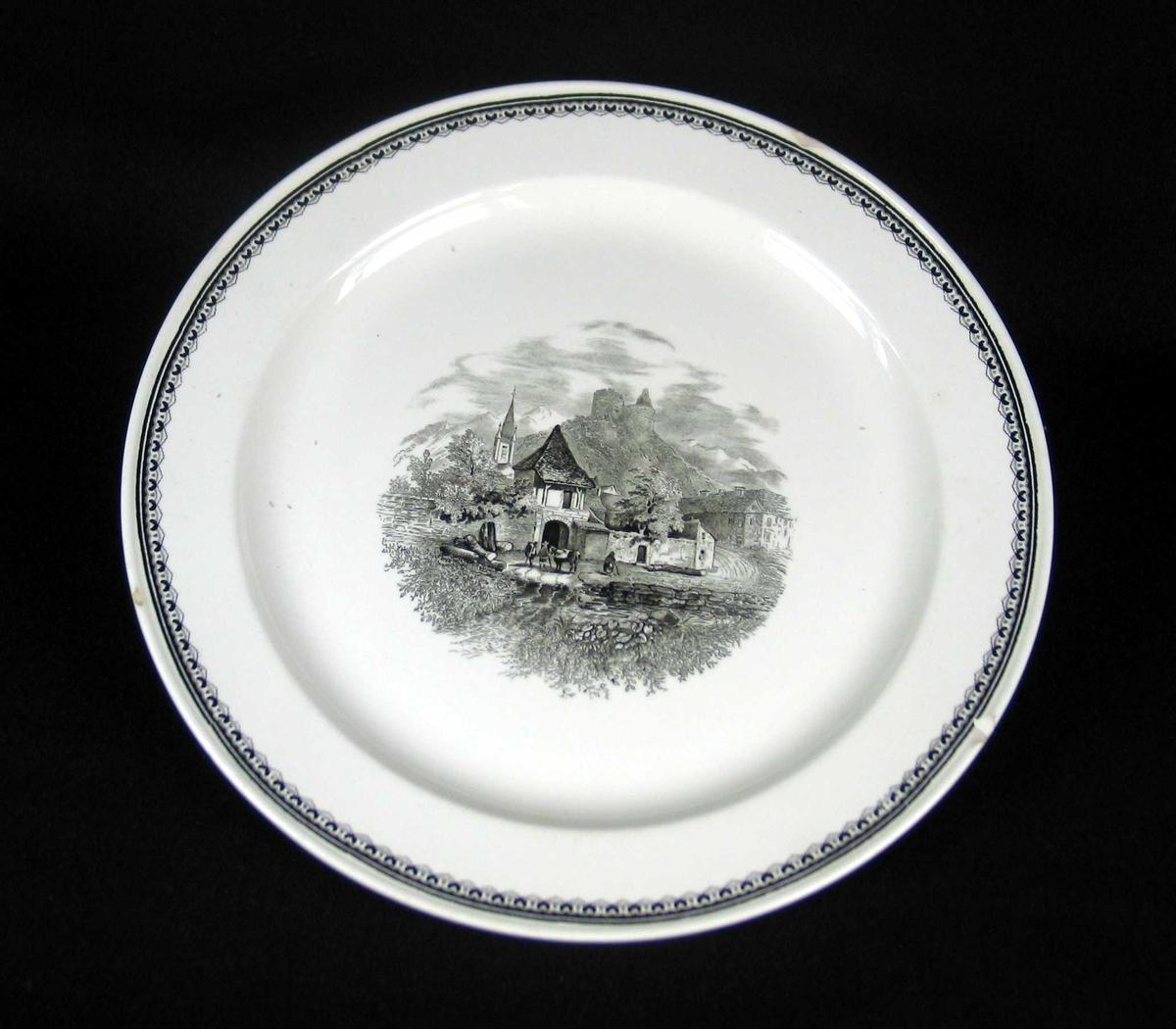 Rundt serveringsfat i offwhite keramikk med sort dekor.