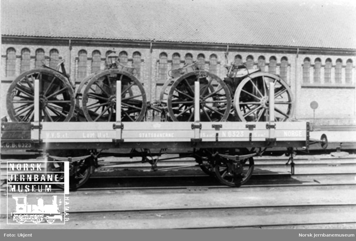 Gjøvikbanens vogn litra N nr. 6323 lastet med artillerimateriell; ammunisjonsvogner